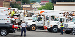 TORRINGTON , CT-080720JS05—Electrical contractor from State Electric Corporation, a company based in Massachusetts, stage their trucks and personnel at the Torrington Plaza on South Main Street in Torrington on Friday morning. <br /> Jim Shannon Republican-American