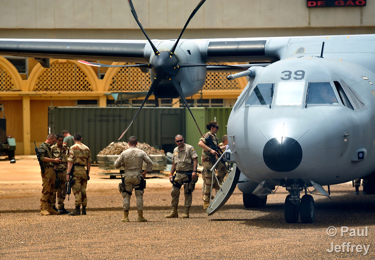 French soldiers board a plane in the airport in Gao, a northern Mali city that was seized by Islamist fighters in 2012 and then liberated by French and Malian soldiers in early 2013.