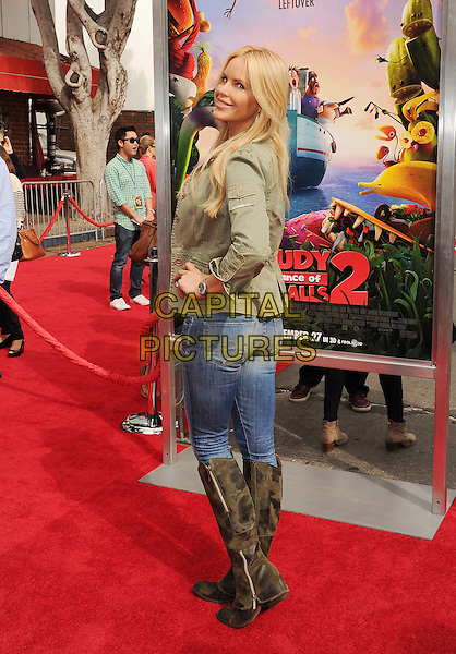 Gina Lee Nolan<br /> &quot;Cloudy With A Chance Of Meatballs 2&quot; Los Angeles Premiere held at Regency Village Theatre, Westwood, California, USA,<br /> 21st September 2013.<br /> full length jeans hand on hip knee high boots suede jacket green looking over shoulder  <br /> CAP/ROT/TM<br /> &copy;Tony Michaels/Roth Stock/Capital Pictures
