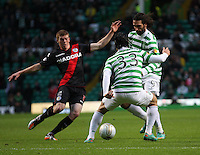 Jon Robertson tackles Georgios Samaras with Beram Kayal close at hand in the Celtic v St Mirren Clydesdale Bank Scottish Premier League match played at Celtic Park, Glasgow on 15.12.12.