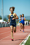 A West Ranch High School female track and field team member runs towards the finish line during the final race of the day at Rio Mesa High School in Oxnard Calif., on Saturday, March 30 2013.