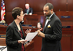 Nevada Assemblywoman Heidi Swank, D-Las Vegas, and Senate Minority Leader Aaron Ford, D-Las Vegas, talk on the Assembly floor at the Legislative Building in Carson City, Nev., on Friday, May 22, 2015. <br /> Photo by Cathleen Allison