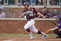 Texas A&M Aggies outfielder Jonathan Moroney (40) follows through on his swing against the LSU Tigers in the NCAA Southeastern Conference baseball game on May 10, 2013 at Blue Bell Park in College Station, Texas. LSU defeated Texas A&M 7-4. (Andrew Woolley/Four Seam Images).