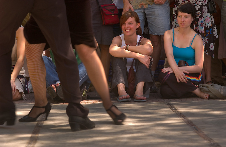 Katharina Wiest, center, and Laudia Manthey, right, of Germany, watch tango performers in the Plaza Dorrego in Buenos Aires.<br /><br />Manthey can be reached at +49-30-2935-2150 or claudia.manthey@berlin.de after 3/5<br /><br />Wiest wll be travelling until September, but can be reached by e-mail at katha.wiest@web.de or by phone after September at +49-711-311-225 <br /><br />(Kevin Moloney for the New York Times)