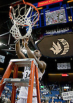 March 1, 2012: Nevada Wolf Pack guard Malik Story celebrates by cutting down the net after the game against the  New Mexico State Aggies played at Lawlor Events Center on Thursday night in Reno, Nevada. Nevada (24-5, 12-1 WAC) won its fourth outright Western Athletic Conference title after defeating New Mexico State (22-9, 9-4 WAC) 65-61.