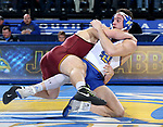 BROOKINGS, SD - NOVEMBER 17: Martin Mueller from South Dakota State tries to keep his balance against Owen Webster from the University of Minnesota during their 184 pound match Friday evening at First Arena in Brookings, SD.  (Photo by Dave Eggen/Inertia)