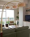 A view of the contemporary den in one of the penthouse suites in the Vistas on the James building in Richmond, Virginia. Interior design by Kathy Corbet Interiors.