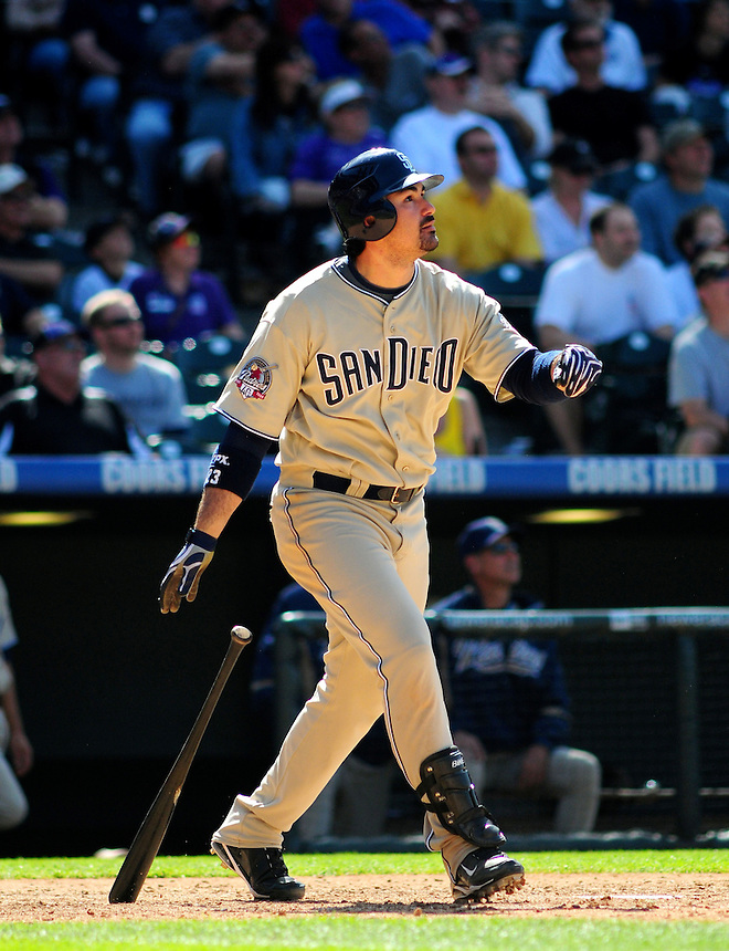 April 29, 2009: Padres 1st baseman Adrian Gonzalez watches the flight of one of two homeruns hit against the Rockies during a game between the San Diego Padres and the Colorado Rockies at Coors Field in Denver, Colorado. The Rockies beat the Padres 7-5.