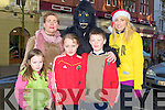 GORILLA: The McCarthy family from Duagh who met up with a Gorilla at the CH Chemist parade on Saturday in Tralee, L-r: Kathleen Ann,Masie and Charlie McCarthy,Gorilla and Edel Fitzpatrick............................ ..........