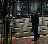 Boston, MA - August 29, 2009 -- US President Barack Obama walks along Darmouth in Boston in the rain after meeting with Victoria Reggie Kennedy, the widow of US Senator Edward M. Kennedy in a nearby hotel in Boston Massachusetts USA 29 August 2009. President Obama will deliver the eulogy later in the day for US Senator Edward M. Kennedy during the funeral mass held at the Lady of Perpetual Health Catholic Church. .Credit: CJ  Gunther - Pool via CNP