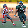 Lindenhurst No. 27 Gino Bonagura, right, returns a kick after recording a sack for a safety in the first quarter of a Suffolk County Division I varsity football game against Connetquot at Lindenhurst Middle School on Friday, September 18, 2015.<br /> <br /> James Escher