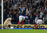 James McFadden rounds the keeper to score goal no 2 for Scotland