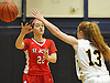 Megan McBrien #22 of St. John the Baptist, left, passes under pressure from Meghan Lucey #13 of Wantagh during a non-league varsity girls basketball game at Baldwin High School on Monday, Dec. 26, 2016. Baptist won by a score 57-47.
