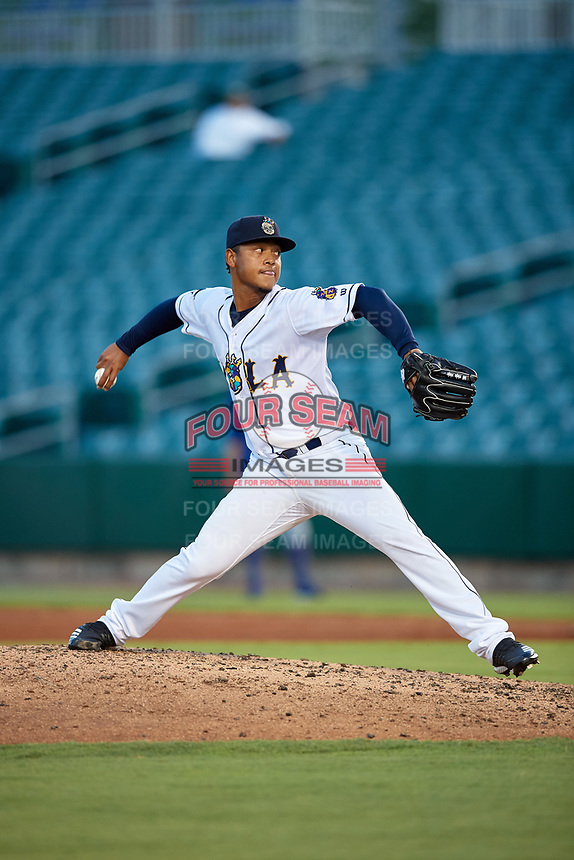 New Orleans Baby Cakes starting pitcher Elieser Hernandez (19) during a Pacific Coast League game against the Oklahoma City Dodgers on May 6, 2019 at Shrine on Airline in New Orleans, Louisiana.  New Orleans defeated Oklahoma City 4-0.  (Mike Janes/Four Seam Images)