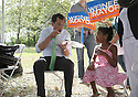 Mayoral candidate Anthony Weiner grabs a bite while making a campaign stop at Baisley Pond Park on Saturday, Sept. 7, 2013 Queens, New York. (AP Photo/ Donald Traill)