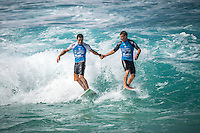 Pipeline,  OAHU - HAWAII, USA: (Wednesday, December 16, 2015): Glen Hall (IRL)  and Adriano de Souza (BRA) at the last event of his pro career. - The Billabong Pipe Masters in Memory of Andy Irons was  called back ON this morning with Round 3 commencing at 8am in solid eight-to-ten foot (2.5 - 3 metre) waves at the Banzai Pipeline. <br />  <br /> The final stop of the Men&rsquo;s Championship Tour and Vans Triple Crown of Surfing (a WSL Specialty Series), the Billabong Pipe Masters will decide the 2015 World Champion, the 2016 elite tour class and the Vans Triple Crown of Surfing Champion by the end of the event.<br />  Photo: joliphotos.com