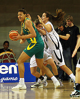 Opals forward Elizabeth Cambage looks for support under pressure from Georgina Richards and Kim Barnes during the International women's basketball match between NZ Tall Ferns and Australian Opals at Te Rauparaha Stadium, Porirua, Wellington, New Zealand on Monday 31 August 2009. Photo: Dave Lintott / lintottphoto.co.nz
