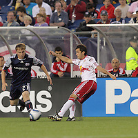 New York Red Bulls midfielder Sinisa Ubiparipovic (8) passes the ball as New England Revolution defender Seth Sinovic (27) closes. The New England Revolution defeated the New York Red Bulls, 3-2, at Gillette Stadium on May 29, 2010.