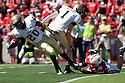 11 September 2010: Nebraska linebacker Mathew May (36) grabs the foot of Idaho running back Princeton McCarty (20) on the 12 yard kick return at Memorial Stadium in Lincoln, Nebraska. Nebraska defeated Idaho 38 to 17.