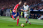 Atletico de Madrid Juanfran Torres and Real Madrid Karim Benzema during La Liga match between Atletico de Madrid and Real Madrid at Wanda Metropolitano in Madrid, Spain. November 18, 2017. (ALTERPHOTOS/Borja B.Hojas)