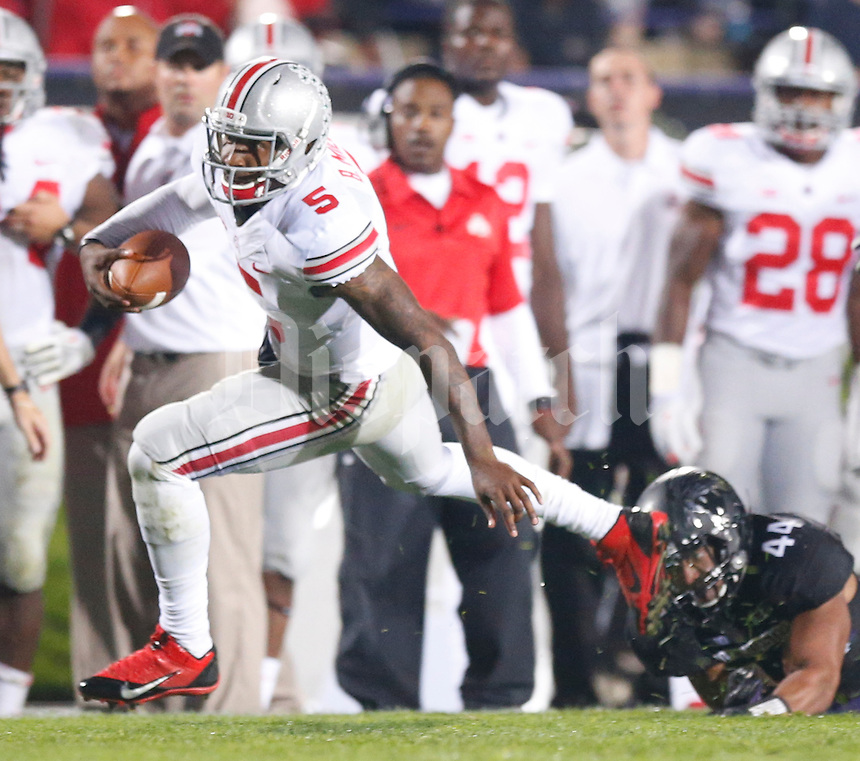 Ohio State Buckeyes quarterback Braxton Miller (5)  slips a tackle by Northwestern Wildcats linebacker Chi Chi Ariguzo (44) during Saturday's NCAA Division I football game at Ryan Field in Evanston on October 5 2013. (Barbara J. Perenic/The Columbus Dispatch)