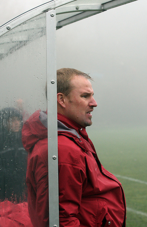 Matt Potter, Washington State University Head Women's Soccer Coach, watches nervously as his Cougars went in to double overtime in the fog at the Lower Soccer Field during their match with the Arizona State Sun Devils in Pullman, Washington, on November 9, 2008.  The Cougars needed a victory for a chance at an NCAA bid and they finally prevailed, 1-0, on a dramatic goal by Elysse Van Leer in the second overtime.