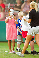 A young fan has a face full of whipped cream after losing an on field contest between innings of the Coastal Plain League game between the Thomasville HiToms and the Gastonia Grizzlies at Sims Legion Park on June 2, 2011 in Gastonia, North Carolina.  The Hi-Toms defeated the Grizzlies 9-4.  Photo by Brian Westerholt / Four Seam Images
