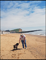 BNPS.co.uk (01202)558833<br /> Pic: Amber Whiting/BNPS<br /> <br /> Shadow and owner Amber on the beach at West Bay, close to the scene of his ordeal.<br /> <br /> A pet dog that was feared to have died when it fell off the top of 550ft cliff has miraculously been found alive after spending 45 days stuck on a ledge.<br /> <br /> Shadow, a Shar Pei, was discovered in an emaciated state having lost over half his body weight during the six weeks he was trapped on the seaside cliff near Eype, Dorset.