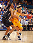 SIOUX FALLS, SD - MARCH 9:  Katie Lingle #42 from South Dakota State University drives against Sinclair Russell #35 from Oakland University in the first half of their game at the Sioux Falls Arena during the 2013 Summit League Tournament Saturday afternoon. (Photo by Dave Eggen/Inertia)