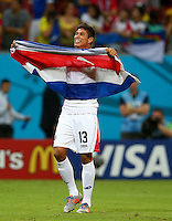 Oscar Granados of Costa Rica celebrates victory in the penalty shootout and progressing to the quarter finals