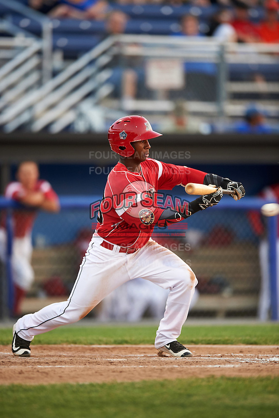 Batavia Muckdogs shortstop Samuel Castro (25) lays down a bunt during a game against the Brooklyn Cyclones on July 5, 2016 at Dwyer Stadium in Batavia, New York.  Brooklyn defeated Batavia 5-1.  (Mike Janes/Four Seam Images)