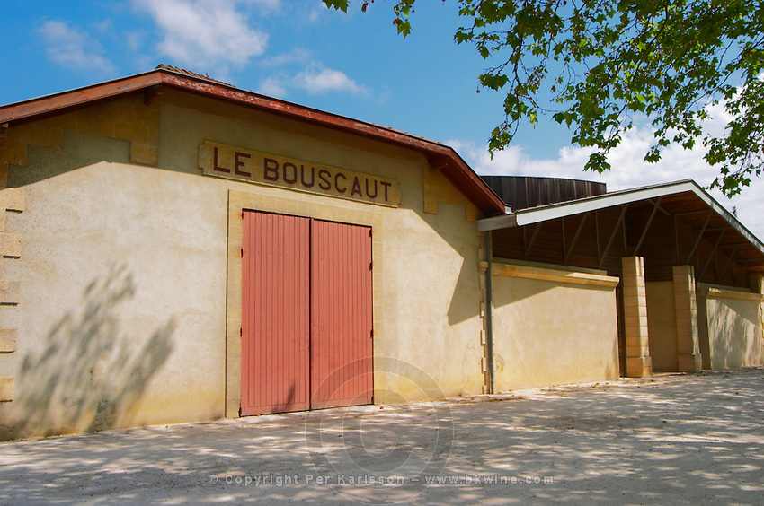 The modern and old winery building and vat hall with a sign saying Le Bouscaut  Chateau Bouscaut Cru Classe Cadaujac  Graves Pessac Leognan  Bordeaux Gironde Aquitaine France