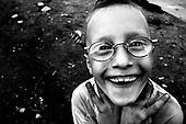 Wroclaw 24.08.2006 Poland<br /> The worst and the most dangerous district in Wroclaw ( Poland ), called by people &quot;The Bermuda Triangle&quot;. There are walls bearing an inscription &quot;Who will enter here, will not exit alive&quot; Many families there are pathological and live in extreme poverty. Children have no place for any games so they loaf around on this wasted district and disseminate a juvenile delinquency. Many of them become sexually active though they are only 10-12 years old<br /> (Photo by Adam Lach / Napo Images)<br /> <br /> Najbardziej nabezpieczna dzielnica we Wroclawiu zwana przez ludzi Trojkatem Bermudzkim. Sa tam sciany opatrzone napisem &quot; Kto tu wejdzie, nigdy nie wyjdzie stad zywy&quot; Mieszka tam wiele rodzin patologicznych i zyja w wielkiej nedzy. Dzieci wlocza sie po ulicach nie majac miejsc na zabawe i szerza przestepczosc wsrod nieletnich. Wiele z dzieci uprawia seks choc maja zaledwie 10-12 lat<br /> (Fot Adam Lach / Napo Images)