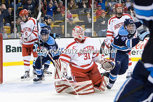 Spencer Abbott (Maine - 13), Joey Diamond (Maine - 39) and Matt Mangene (Maine - 57) celebrate Will O'Neill's second goal which gave Maine its first lead late in the second period. - The University of Maine Black Bears defeated the Boston University Terriers in their Hockey East semi-final 5-3 (EN) on Friday, March 16, 2012, at TD Garden in Boston, Massachusetts.