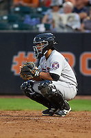 Tri-City ValleyCats catcher Richard Gonzalez (11) warms up the pitcher during a game against the Aberdeen Ironbirds on August 6, 2015 at Ripken Stadium in Aberdeen, Maryland.  Tri-City defeated Aberdeen 5-0 in a combined no-hitter.  (Mike Janes/Four Seam Images)