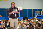 WINSTED, CT-011518JS03---Chris Evers, Director and Founder of Animal Embassy of Stamford, holds an alligator during an anti-bulling program Tuesday at the Batcheller Early Education Center in Winsted. Evers said he created the anti-bulling program because of his experiences of being bullied as a child. The program was sponsored by the Parent Teacher Organization. <br /> Jim Shannon Republican-American