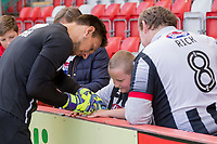 A Grimsby fan collects an autograph ahead of the Sky Bet League 2 match between Cheltenham Town and Grimsby Town at the The LCI Rail Stadium,  Cheltenham, England on 17 April 2017. Photo by PRiME Media Images / Mark Hawkins.