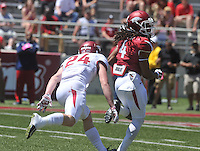 NWA Democrat-Gazette/Michael Woods --04/25/2015--w@NWAMICHAELW... University of Arkansas receiver Keon Hatcher slips past defensive back Ryder Lucas during the 2015 Red-White game Saturday afternoon at Razorback Stadium in Fayetteville.