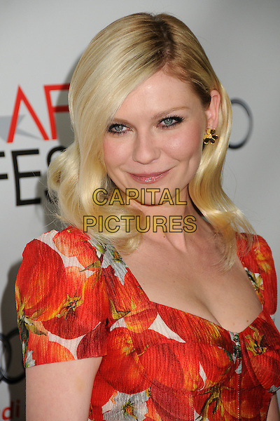 "Kirsten Dunst  .AFI Fest 2011 Special Screening of ""Melancholia"" held at the Egyptian Theater, Hollywood, California, USA..November 6th, 2011.headshot portrait white orange floral red print .CAP/ADM/BP.©Byron Purvis/AdMedia/Capital Pictures."