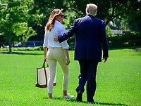 First lady Melania Trump joins United States President Donald J. Trump on the South Lawn of the <br /> White House in Washington, DC after he made remarks and answered reporter's questions as he prepares to depart on Friday, July 5, 2019.  The President will travel to Westminster, New Jersey for the weekend. Photo Credit: Ron Sachs/CNP/AdMedia
