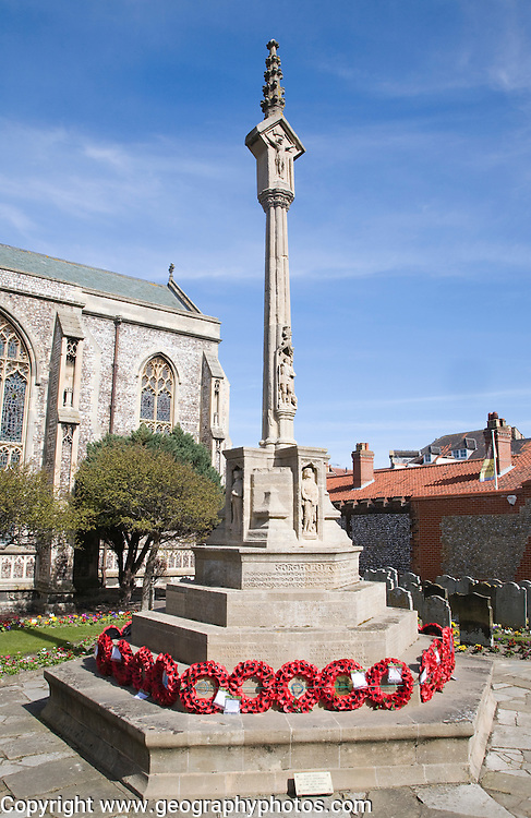 War memorial with remembrance wreaths, Cromer, Norfolk, England