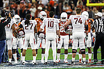 Arkansas Razorbacks and Texas Longhorns hold the coin toss before the Advocare V100 Texas Bowl game between the Arkansas Razorbacks and the Texas Longhorns at the NRG Stadium in Houston, Texas. Arkansas defeats Texas 31 to 7.