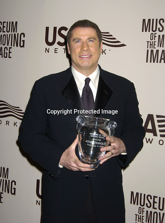 John Travolta ..at the American Museum of the Moving Image salute to John Travolta on December 5, 2004 at The Waldorf Astoria ..Hotel. ..Photo by Robin Platzer, Twin Images