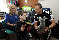 Pictured L-R: Project leader Judy Lynch with 10 year old James Morris and Swansea City FC ambassador Lee Trundle. Monday 17 March 2014<br /> Re: Swansea City FC Ambassador, Lee Trundle has visited The Play and Leisure Opportunities Library (PLOL) to see how Comic Relief money is making a difference to vulnerable people in Swansea. The PLOL provides play sessions for children and adults with profound disabilities. A small Comic Relief grant has allowed the group to purchase and cover the insurance cost of sensory toys which they loan to families