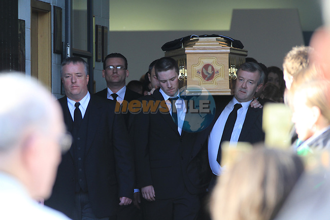 The funaral of Niall Dorr arriving at The Church of The Holy Family, Muirhevnamor, Dundalk. His brother Shane carries the coffin from the church.Picture Fran Caffrey/www.newsfile.ie.