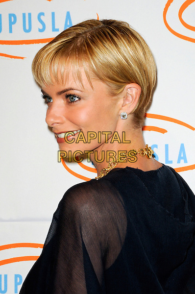 JAIME PRESSLY.Lupus LA's 7th Annual Bag Ladies Luncheon to raise funds for lupus research at the Beverly Wilshire Four Seasons Hotel in Beverly Hills, California, USA..November 18th, 2009.headshot portrait Jamie Pressley black navy blue sheer profile through thru fringe.CAP/ROT.©Lee Roth/Capital Pictures