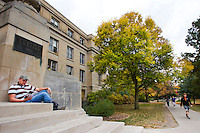 Agriculture business student Gunnar Hansen of Kankakee, Ill., reads on the steps of Curtiss Hall on the campus of Iowa State University in Ames, Iowa. (Christopher Gannon/Gannon Visuals)