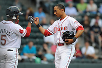 Second baseman Mookie Betts (7) of the Greenville Drive, right, is congratulated by Aneury tavarez after scoring a run in a game against the Augusta GreenJackets on Friday, May 10, 2013, at Fluor Field at the West End in Greenville, South Carolina. (Tom Priddy/Four Seam Images)