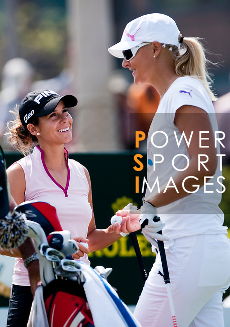 TAOYUAN, TAIWAN - OCTOBER 22: Anna Nordqvist (R) of Sweden and Azahara Munoz of Spain laugh on the 1st hole during day three of the LPGA Imperial Springs Taiwan Championship at Sunrise Golf Course on October 22, 2011 in Taoyuan, Taiwan. Photo by Victor Fraile / The Power of Sport Images