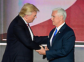 Donald Trump, the GOP nominee for President of the United States greets Governor Mike Pence (Republican of Indiana), the GOP nominee for Vice President of the United States following the Governor's acceptance speech at the 2016 Republican National Convention held at the Quicken Loans Arena in Cleveland, Ohio on Wednesday, July 20, 2016.<br /> Credit: Ron Sachs / CNP<br /> (RESTRICTION: NO New York or New Jersey Newspapers or newspapers within a 75 mile radius of New York City)
